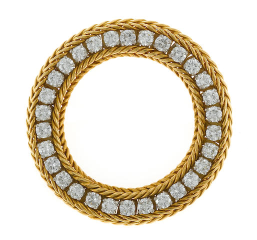 A diamond circle brooch