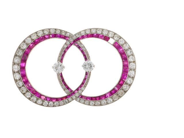 An art deco diamond and synthetic ruby double circle brooch,