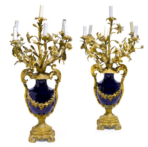 A pair of Sevres style porcelain gilt bronze mounted five light candelabra <BR />Henri Picard<BR />second half 19th century