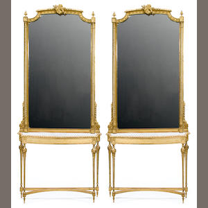 A pair of Louis XVI style carved giltwood consoles and pier mirrors . circa 1900