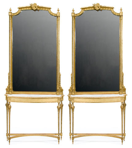 A pair of Louis XVI style carved giltwood consoles and pier mirrors <BR />circa 1900