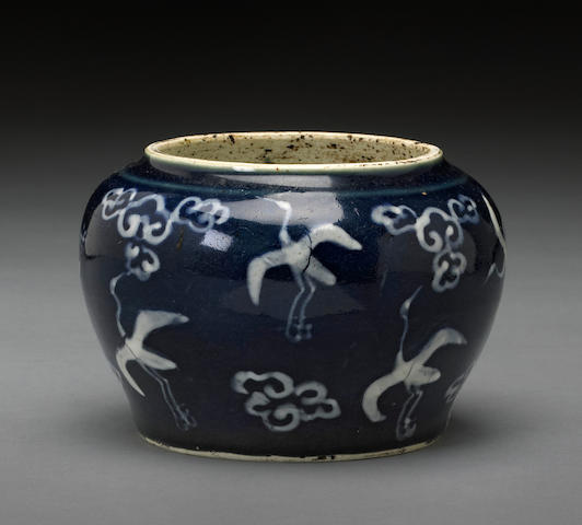 A small cobalt glazed porcelain jar with white slip decoration Wanli period