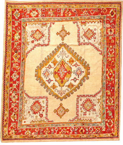 An Oushak carpet  West Anatolia size approximately 10ft. 8in. x 12ft. 9in.