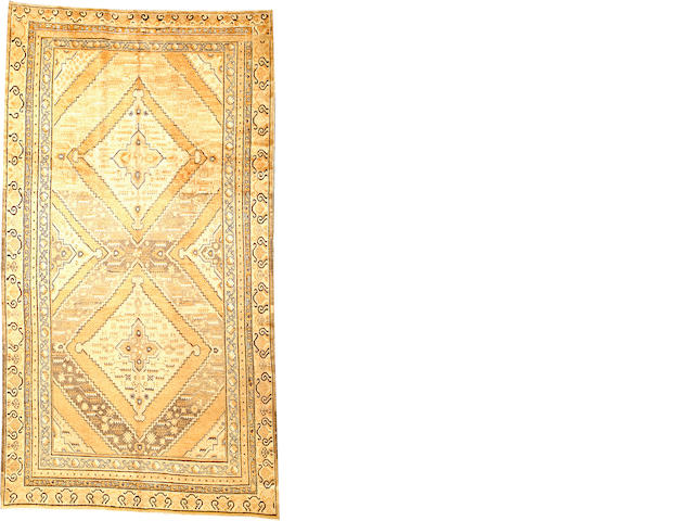 A Khotan long carpet  Turkestan size approximately 6ft. 9in. x 12ft. 4in.
