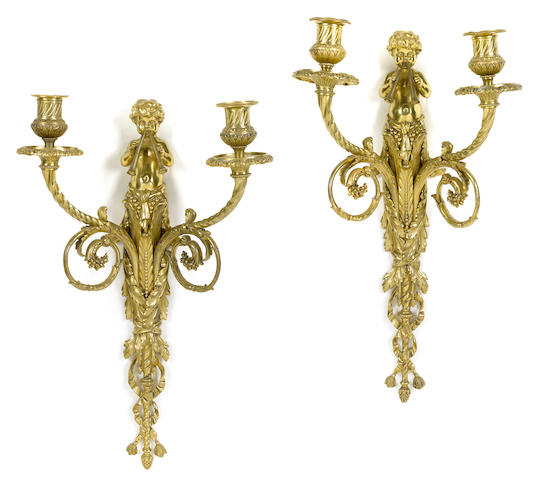 A pair of Louis XVI style gilt bronze two light bras de lumiere <BR />late 19th century