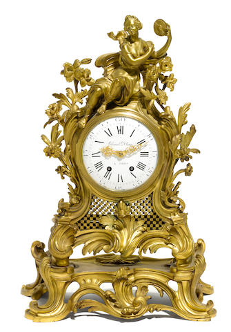A Louis XV style gilt bronze mantel clock  late 19th century