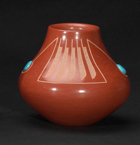A San Ildefonso redware sgraffito jar