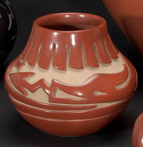 A Santa Clara carved redware jar
