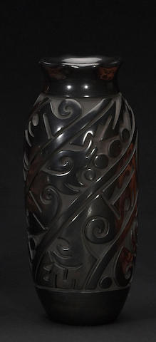 A Santa Clara carved blackware cylinder jar