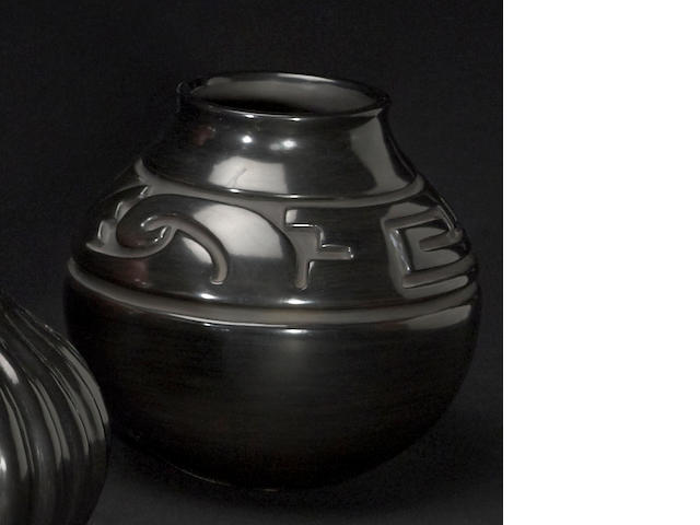 A Santa Clara carved blackware jar