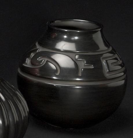 A Santa Clara carved blackware jar