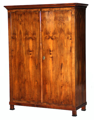 A Biedermeier parcel ebonized walnut armoire first half 19th century