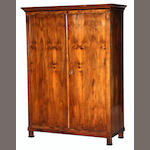A Biedermeier parcel ebonized walnut armoire<BR />first half 19th century