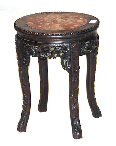 A Chinese carved wood marble inset side table