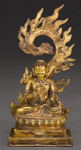 A Tibetan gilt bronze model of Acala