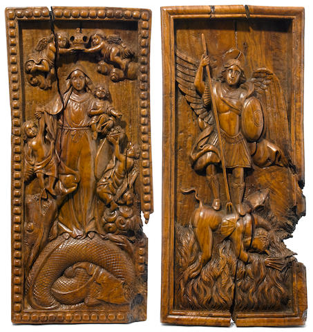 Two Continental carved walnut panels  19th century