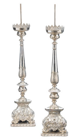 An imposing pair of Italian Baroque style silvered metal prickets  <BR />first half 20th century