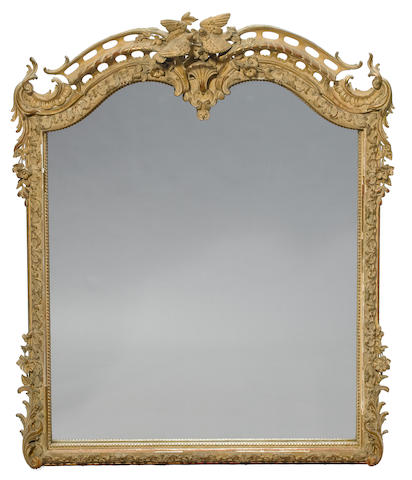 A Napoleon III parcel gilt and paint decorated carved wood and gesso mirror <BR />third quarter 19th century
