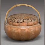 A reticulated copper hand warmer Late Qing dynasty