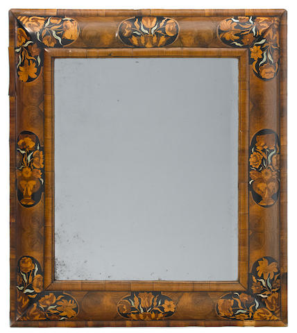 A good William and Mary floral marquetry and walnut oyster veneered cushion frame mirror  <BR />late 17th century