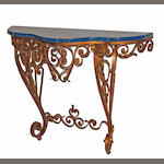 An Italian Rococo style gilt iron and faux marble console table first half 20th century