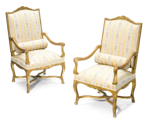 A pair of Régence style carved giltwood fauteuils  <BR />late 19th century