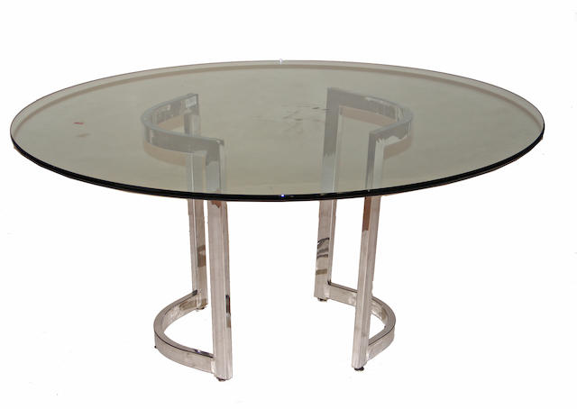 A contemporary chromed metal and glass table