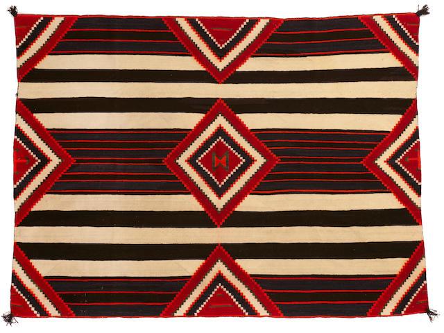 A Navajo Teec Nos Pos chief's design rug