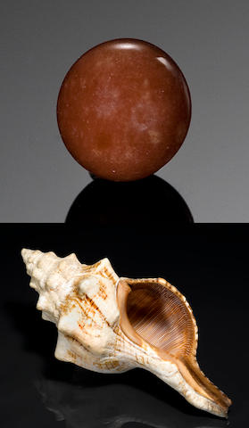 Brown Non-nacreous Natural Pearl 1.93 cts. together with a spiraled tapered mollusk.