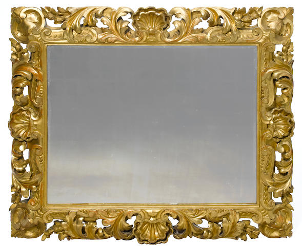 An Italian Baroque style carved giltwood mirror <BR />19th century