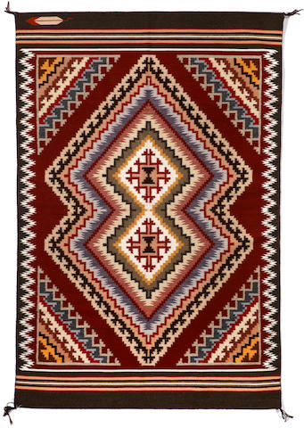 A Navajo Burnt Water rug