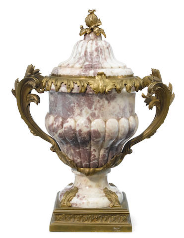 A French gilt bronze mounted carved fleur de pêcher marble covered urn  <BR />possibly François Linke<BR />late 19th century