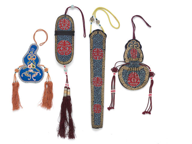 A group of four embroidered silk accessories, including an eyeglass case, fan case and double gourd pouch in matching counted stitch, the fourth an embroidered blue satin double gourd pouch [4]