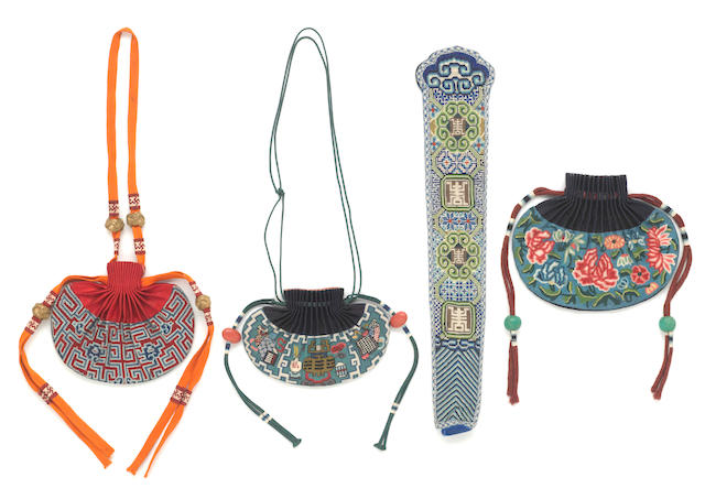 A group of four embroidered silk accessories, including a fan case and two pouches worked in counted stitch and a pouch worked in knotted stitch