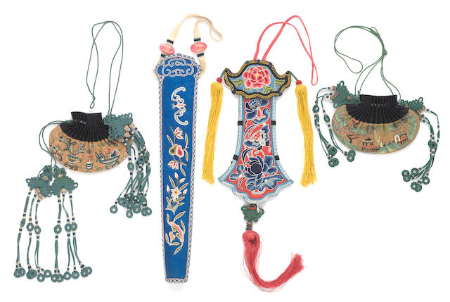 A group of four embroidered silk accessories, including two pouches embroidered on a ground of gilt-woven threads, one fan case in couching technique and one eyeglass case in knotted stitch