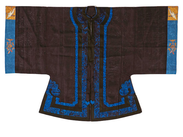 A lady's elaborately embroidered black silk gauze summer coat