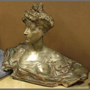 A painted terracotta bust of a young woman after a model by Paul Francois Berthoud (French, 1870-1939). early 20th century