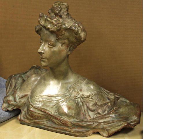 A painted terracotta bust of a young woman after a model by Paul Francois Berthoud (French, 1870-1939)<BR />early 20th century