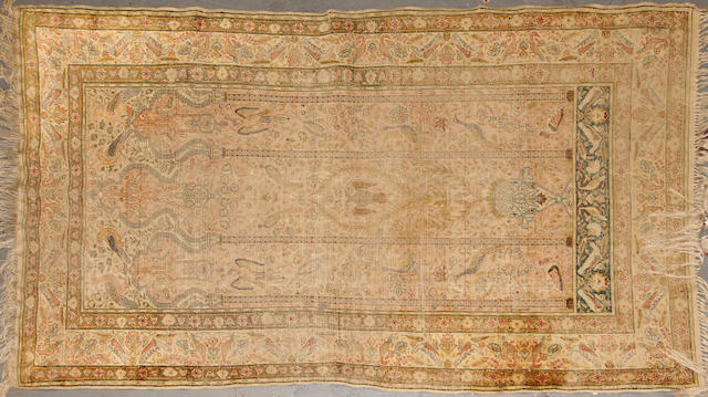 A Turkish silk rug size approximately 4ft. x 6ft. 2in.