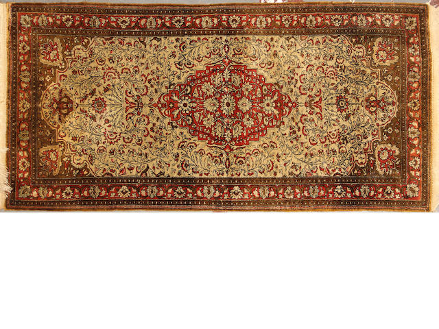 A Qum silk rug  size approximately 2ft. 6in. x 4ft. 10in.