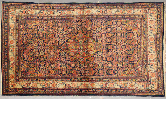 A Tabriz rug  size approximately 3ft. 5in. x 5ft. 1in.