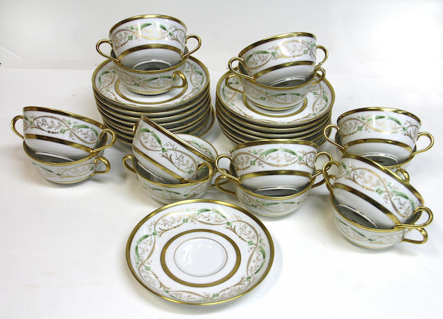 A Ginori porcelain set of fourteen two handled cream soup bowls and stands in the La Scala pattern