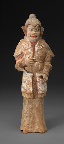 A painted pottery figure of a standing warrior Tang dynasty