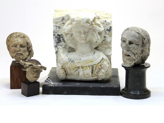 Three European stone carvings and a terracotta head probably 15th/16th century