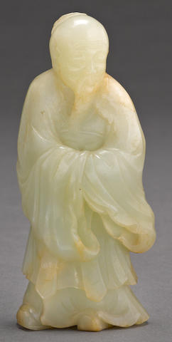 A mottled jade standing figure