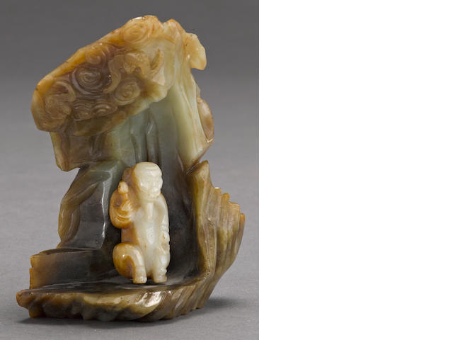 A pieced jade figural group