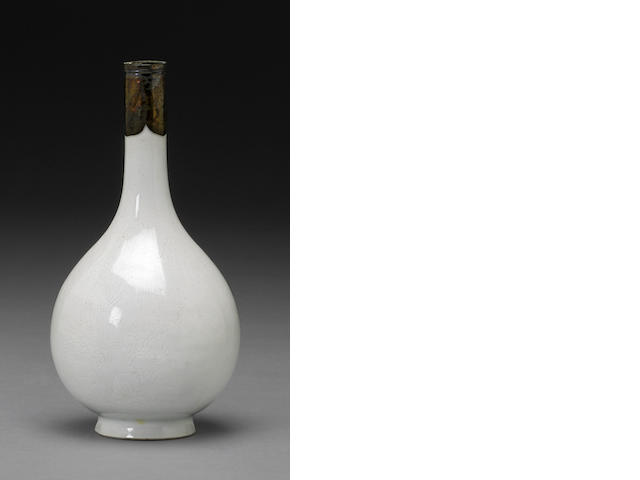 A white glazed porcelain vase with incised decoration 18th century