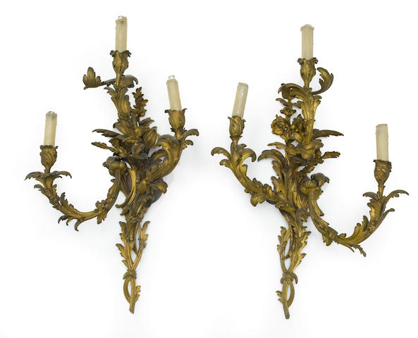 An imposing pair of Louis XV style gilt bronze three light bras de lumière  late 19th century