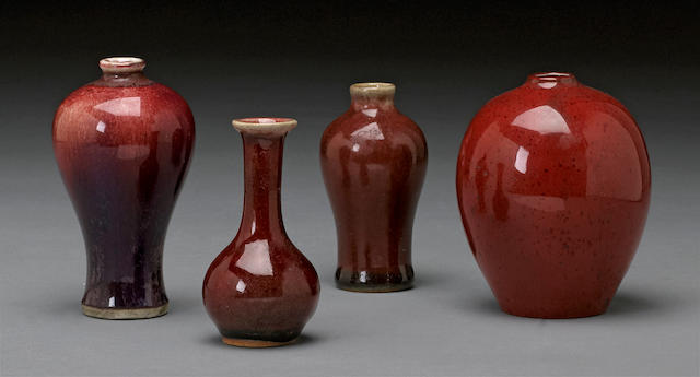 A group of four miniature red glazed porcelain vessels