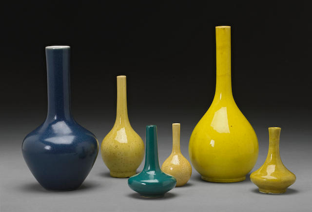 A group of six monochrome porcelain stick neck vases